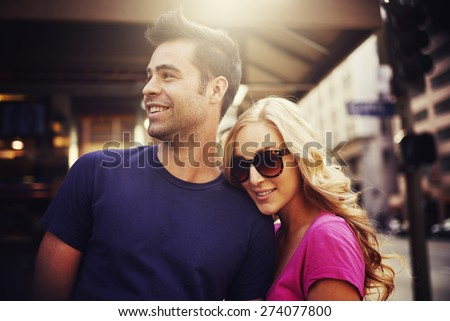 attractive tourist couple in down town los angeles with lens flare and image filter