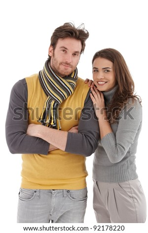Attractive trendy couple hugging, smiling at camera.? - stock photo