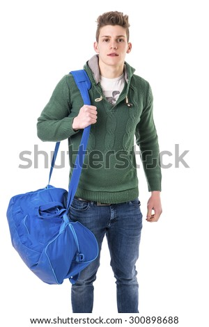 Attractive trendy young man with bag on shoulder strap, isolated on white background, looking at camera - stock photo