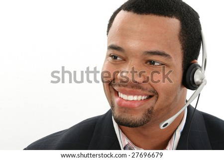 Attractive twenties African American man over white background.  Customer service representative. - stock photo