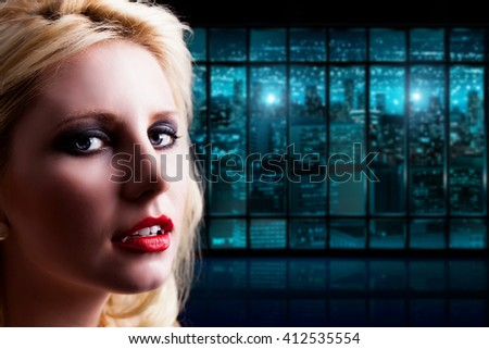 attractive vampire in front of a cityscape at night - stock photo