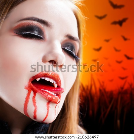 attractive vampire with bloody mouth