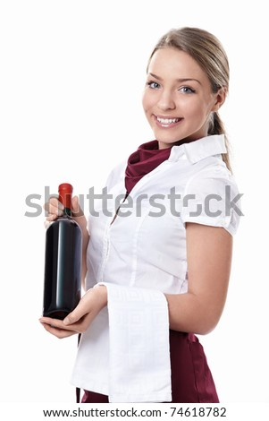Attractive waitress with a bottle of wine on a white background - stock photo