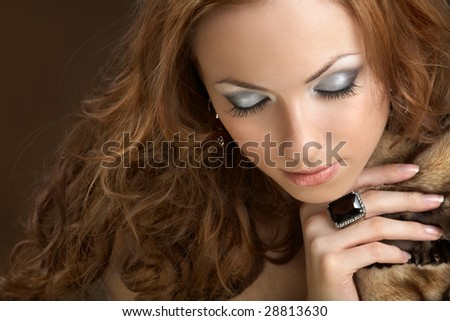 Attractive well dressed woman with closed eyes - stock photo