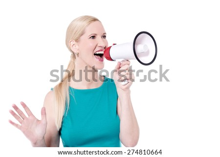 Attractive woman advertisement with megaphone - stock photo