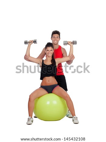 Attractive woman and a personal trainer with weight training - stock photo