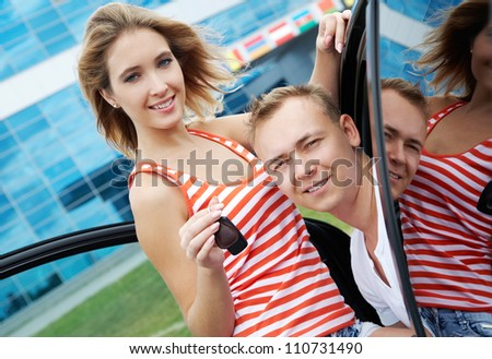 Attractive woman and man in their new modern car - stock photo