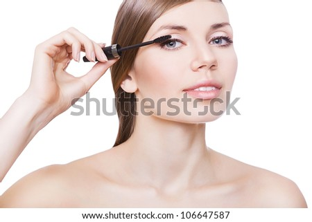 attractive woman and mascara brush on white background