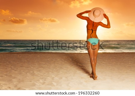 Attractive woman and sunset - stock photo