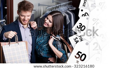 Attractive woman and young man go shopping at the store on clearance sale - stock photo