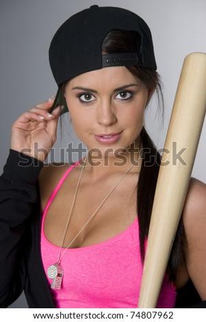 Attractive woman batter up female adjusts baseball cap holding bat chrome whistle  - stock photo