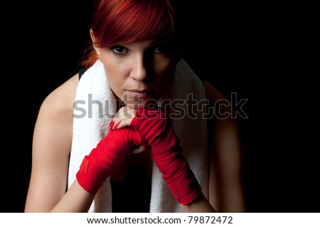 Attractive woman-boxer meditating before the fight - stock photo