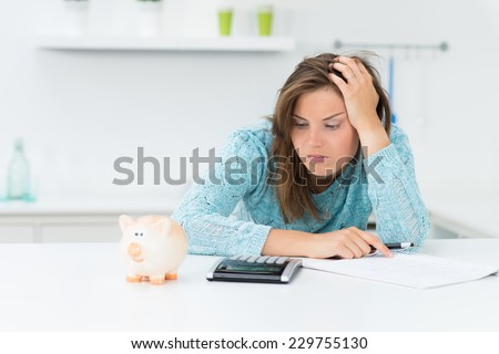 attractive woman calculating household costs - stock photo