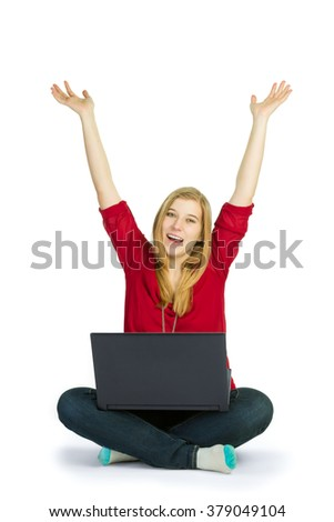 Attractive woman cheering while browsing with a laptop computer - stock photo