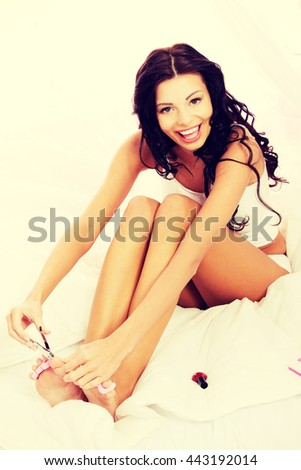 Attractive woman cutting her nails. - stock photo