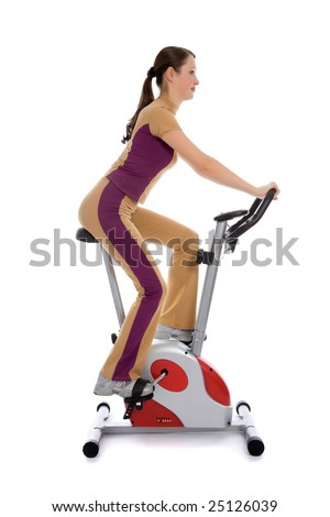 Attractive woman doing fitness on a stationary bike isolated on white