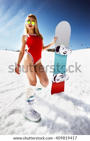 blonde snowboarder girl in bikini