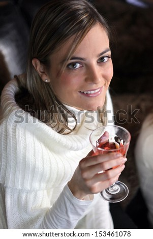 Attractive woman drinking a cocktail - stock photo