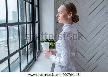 Attractive woman drinking coffe at home.