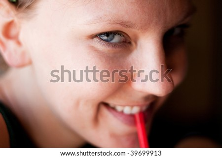 Attractive woman drinking from a straw - stock photo