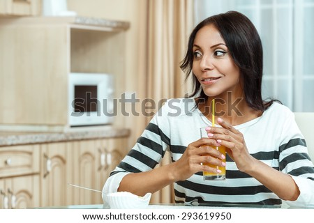 Attractive woman drinking orange juice. - stock photo