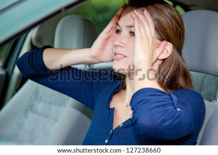 Attractive woman driver in shocked mood. - stock photo