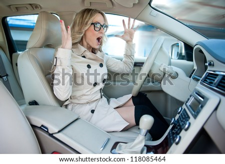 attractive woman driver road rage and panic expression - stock photo