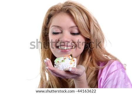 Attractive woman eating a cake