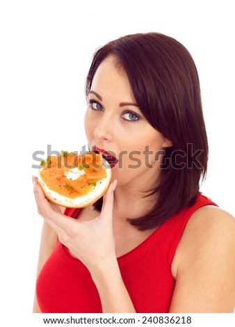 Attractive Woman Eating Smoked Salmon and Cream Cheese Bagel