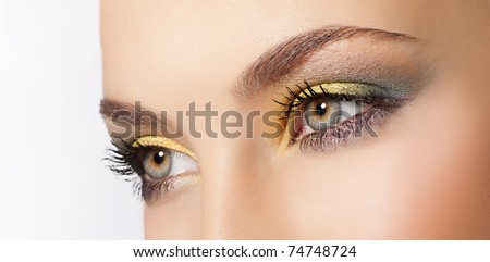attractive  woman eyes closeup on white