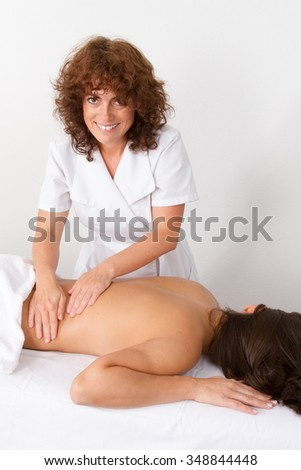 Attractive woman getting spa treatment over a white background