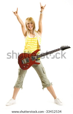 attractive woman guitarist making a rock sign