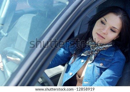 attractive woman happy in new car - stock photo