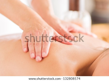 Attractive Woman Having A Massage With Massage Oil In A Spa - stock photo