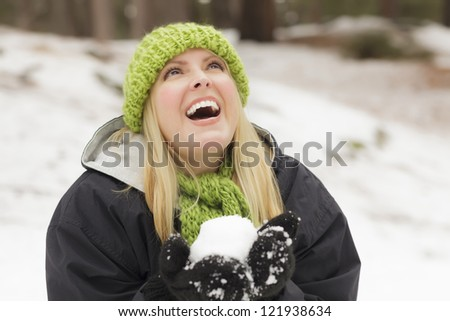 Attractive Woman Having Fun in the Snow on a Winter Day. - stock photo