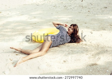 attractive woman having fun, outdoor shot in sand, summer day - stock photo