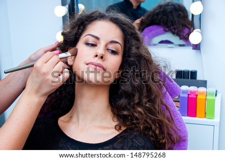 attractive woman having make up applying in salon