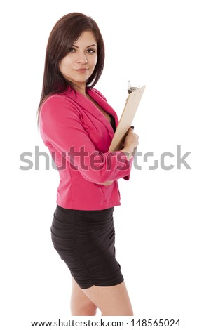 Attractive woman holding a clip board to her chest, isolated on a white background.
