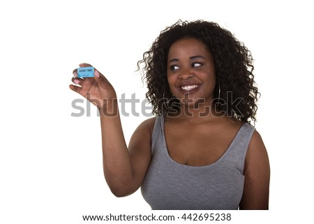 Attractive woman holding a raffle ticket