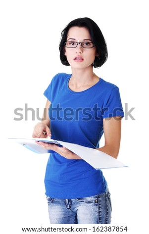 Attractive woman holding a workbook, checking. Isolated on white.