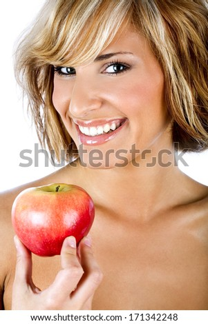 Attractive woman holding an apple, promoting healthy lifestyle