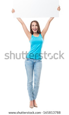Attractive woman holding blank poster