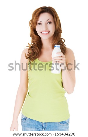 Attractive woman holding white bottle. Isolated on white.