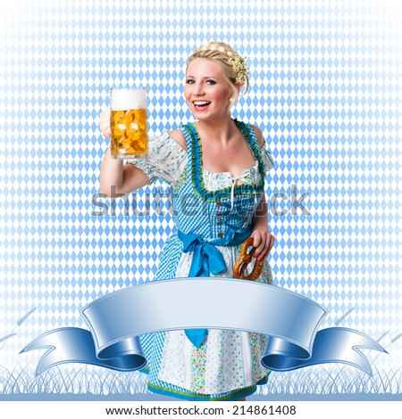 attractive woman in a dirndl with beer and pretzel  - stock photo