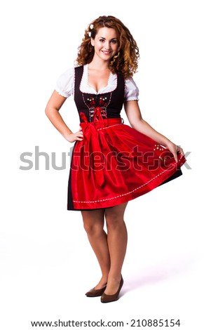 attractive woman in a traditional red dirndl - stock photo