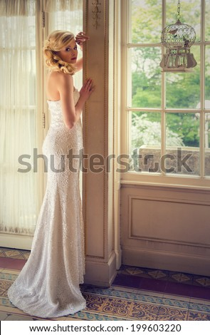 attractive woman in a white sequined long dress - stock photo