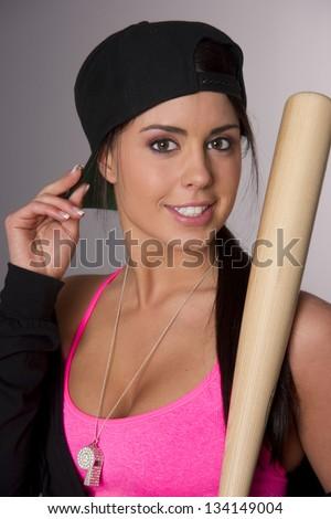 Attractive Woman in Baseball Cap holds her Baseball Bat - stock photo