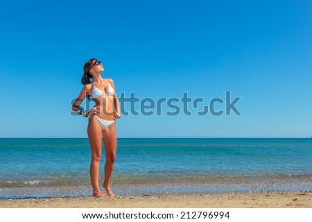 attractive woman in bikini, outdoor on the beach - stock photo