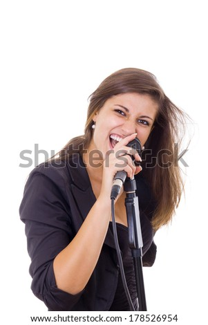 attractive woman in black screaming on microphone singing