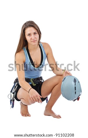Attractive woman in climbing equipment limber up in white background